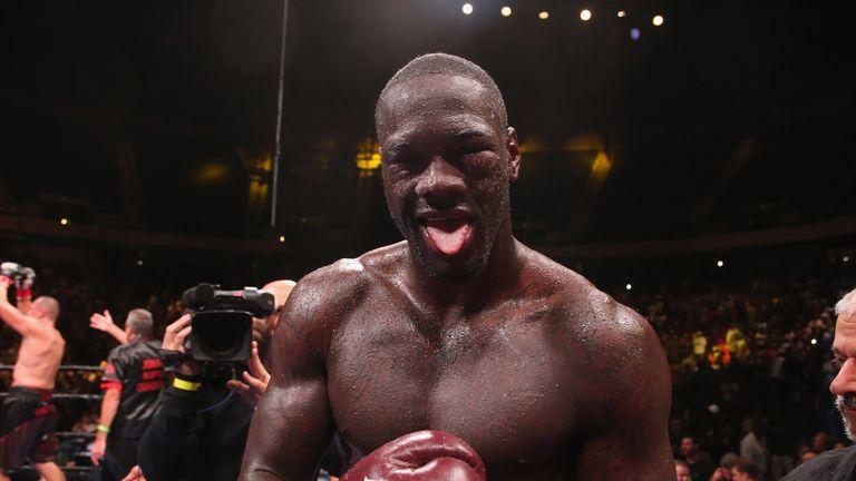 Deontay Wilder poses after beating Johann Duhaupas