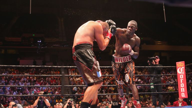 Deontay Wilder lands one of his numerous big punches against Johann Duhaupas