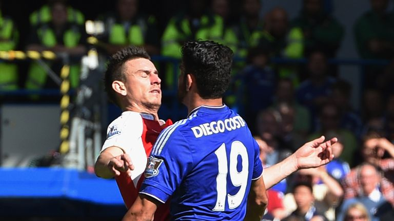 Diego Costa of Chelsea and Laurent Koscielny of Arsenal clash during the Barclays Premier League match between Chelsea and Arsenal at Stamford Bridge