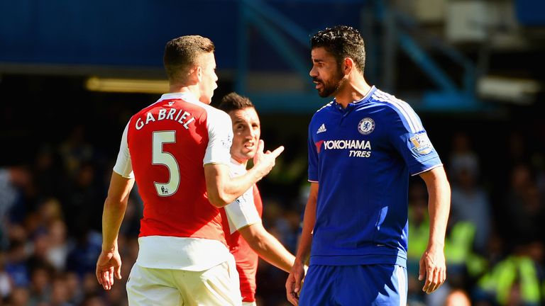 LONDON, ENGLAND - SEPTEMBER 19:  Gabriel of Arsenal and Diego Costa of Chelsea argue during the Barclays Premier League match between Chelsea and Arsenal a