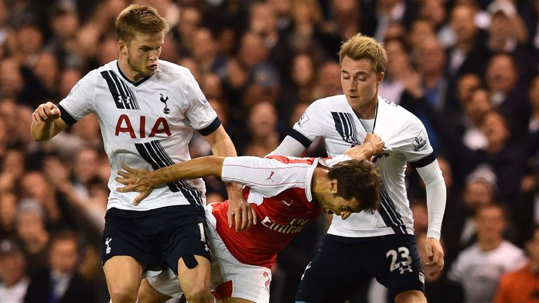 Tottenham Hotspur's Christian Eriksen and Eric Dier battle with Mathieu Flamini for the ball
