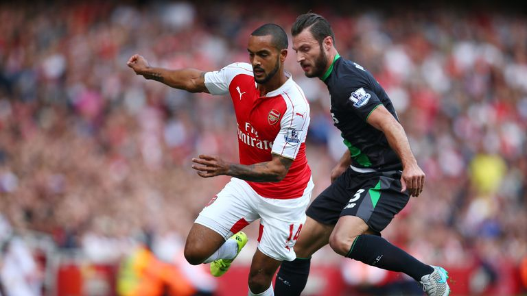 Theo Walcott of Arsenal is closed down by Erik Pieters of Stoke City