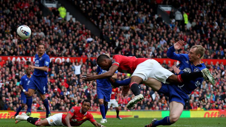 MANCHESTER, ENGLAND - APRIL 22:  Patrice Evra of Manchester United hits the post with a diving header during the Barclays Premier League match between Manc