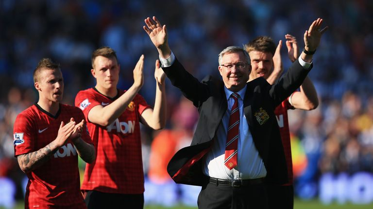 Manchester United manager Sir Alex Ferguson is applauded by players after his 1,500th and final match in charge of the cl
