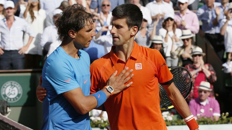 Nadal and Djokovic embrace after the Serb inflicts only Nadal's second ever defeat at Roland Garros in 2015