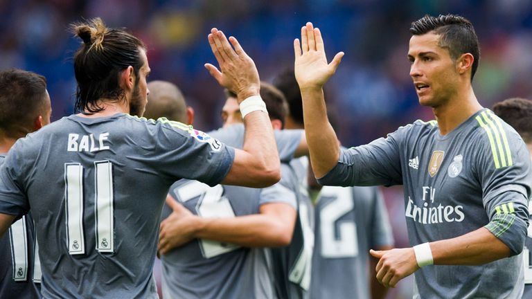 BARCELONA, SPAIN - SEPTEMBER 12: Cristiano Ronaldo (R) of Real Madrid CF is congratulated by his teammate Gareth Bale (L) after scoring his team's sixth go