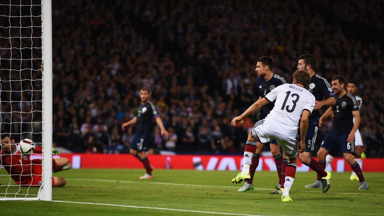 Thomas Mueller of Germany scores Germany's second goal against Scotlandn