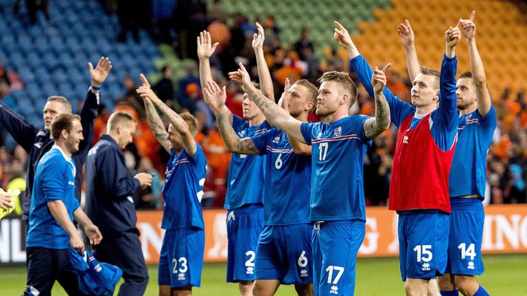Iceland's players jubilate at the end of the UEFA Euro 2016 qualifying round football match between Netherlands and Iceland