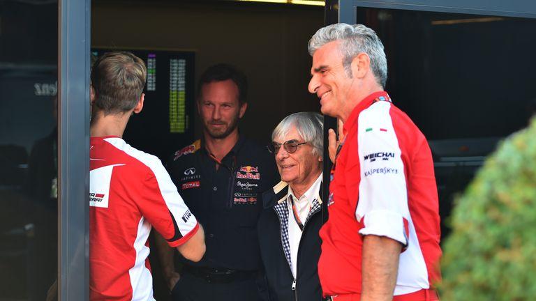 Christian Horner, Bernie Ecclestone and  Maurizio Arrivabene talking at Monza
