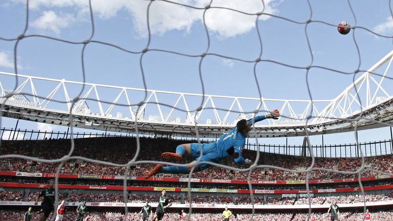 Jack Butland dives accross the Stoke City goal mouth during the English Premier League football match between Arsenal and Stoke