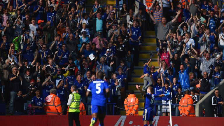 Jamie Vardy of Leicester City celebrates scoring his team's first goal against Arsenal