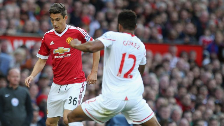 Matteo Darmian of Manchester United in action with Liverpool's Joe Gomez