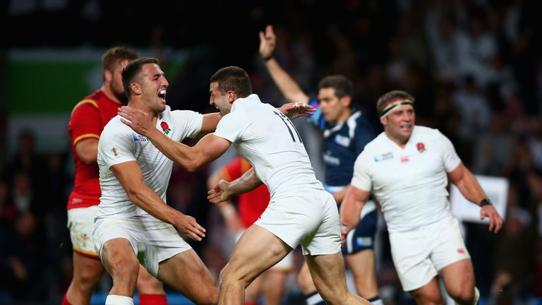 Jonny May celebrates with Burgess after scoring a try against Wales