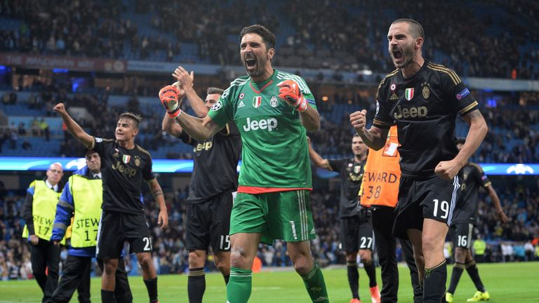 Juventus' goalkeeper Gianluigi Buffon (middle) and defender Leonardo Bonucci (right) celebrate the win