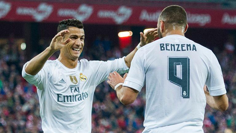 Karim Benzema of Real Madrid CF celebrates after scoring with teammate Cristiano Ronaldo