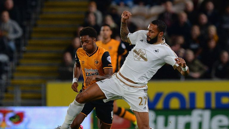 Kyle Bartley of Swansea City tackles Chuba Akpom of Hull City