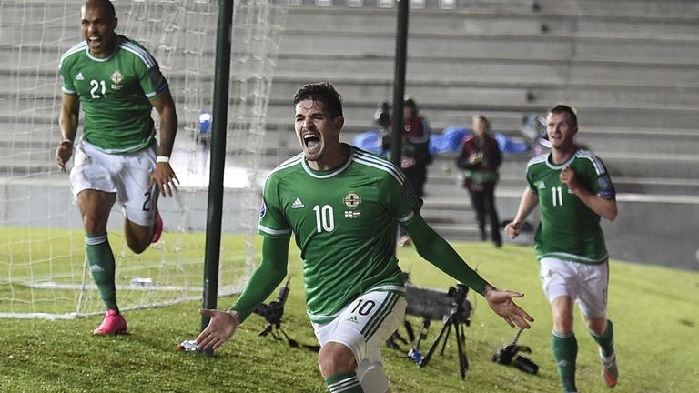 Northern Ireland's striker Kyle Lafferty (C) celebrates after scoring their late equaliser during the Euro 2016 qualifying group F