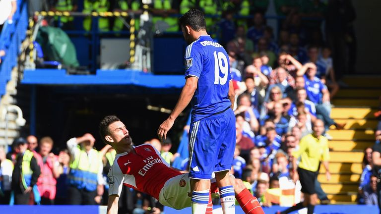 Diego Costa of Chelsea and Laurent Koscielny of Arsenal clash