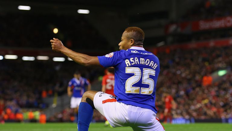 Derek Asamoah of Carlisle United celebrates after scoring his goal during the Capital One Cup Third Round match  against Liverpool