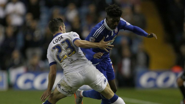 Leeds United's Lewis Cook (left) challenges Ipswich Town's Ainsley Maitland-Niles