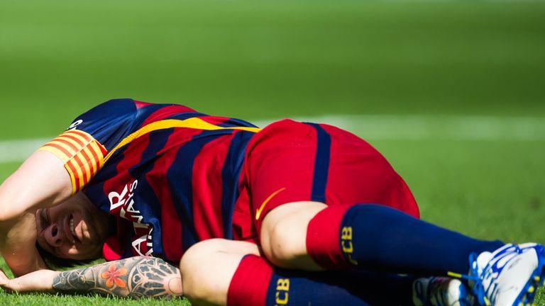 Lionel Messi lies injured against Las Palmas