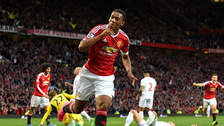 Manchester United's Anthony Martial celebrates scoring his side's third goal against Liverpool