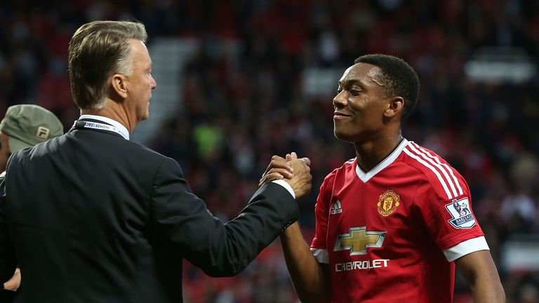 Louis van Gaal congratulates Anthony Martial after the Premier League match between Manchester United and Liverpool