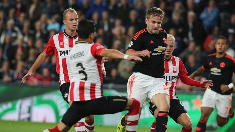 Luke Shaw of Manchester United about to be tackled by Hector Moreno of PSV Eindhoven