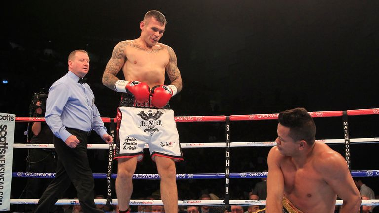 Martin Murray stands over Torres after another knockdown