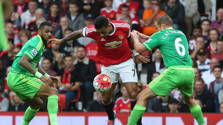 Memphis Depay of Manchester United in action with Lee Cattermole of Sunderland during the Barclays Premier League match at Old Trafford
