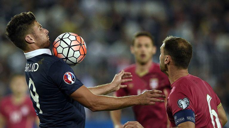 France forward Olivier Giroud (L) controls the ball next to Serbia's defender Branislav Ivanovic