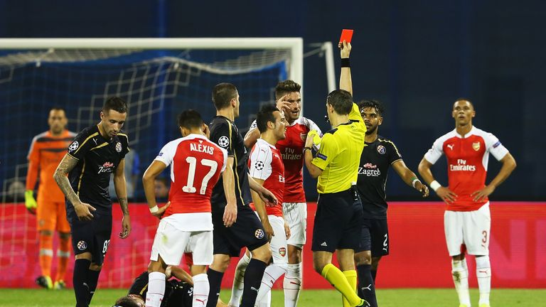 Olivier Giroud of Arsenal is shown the red card