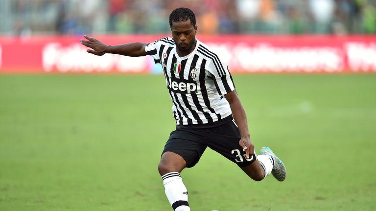 Juventus' defender Patrice Evra kicks the ball