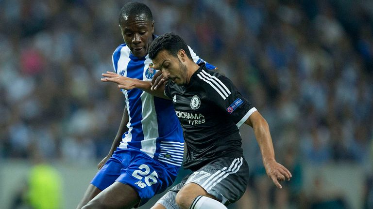 PORTO, PORTUGAL - SEPTEMBER 29: Pedro Rodriguez Ledesma (R) of Chelsea FC competes for the ball with Giannelli Imbula (L) of FC Porto during the UEFA Champ