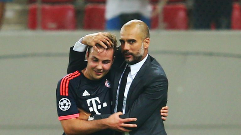 Head coach Pep Guardiola of Bayern Munich hugs Mario Goetze