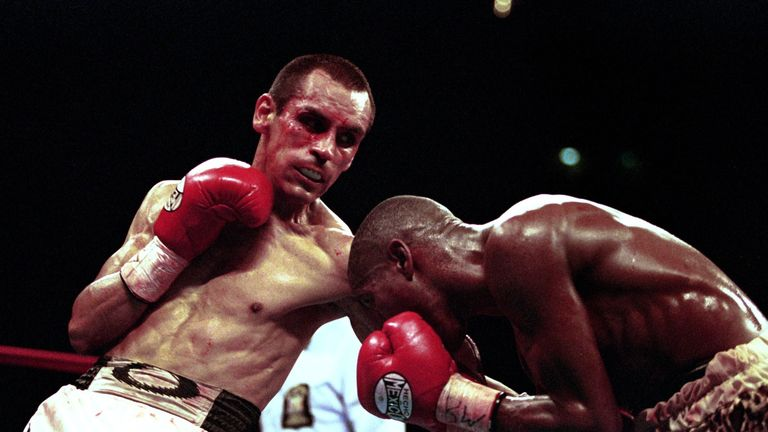 Ricardo Lopez (left) digs in a body blow in his final clash with Zolani Petelo