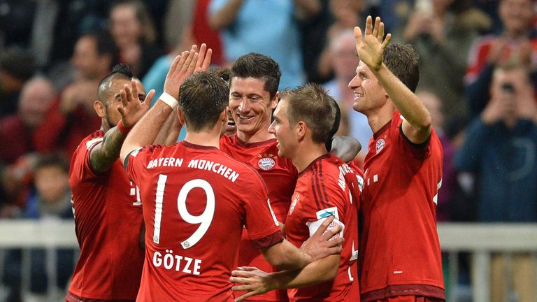 Bayern team-mates celebrate with Lewandowski (c) after his fifth goal