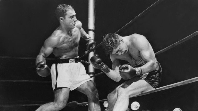 American boxer Rocky Marciano (1923 - 1969) batters Roland La Starza against the ropes in the 11th round of their heavyweight contest at the Polo Grounds,