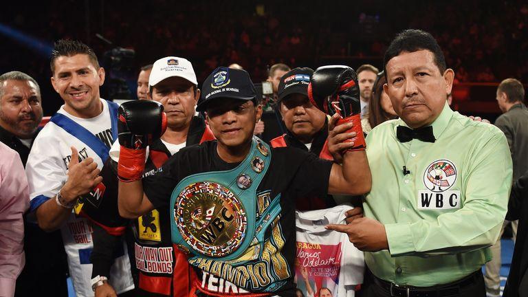 Boxer Roman Gonzalez of Nicaragua (C) celebrates after defeating Edgar Sosa of Mexico