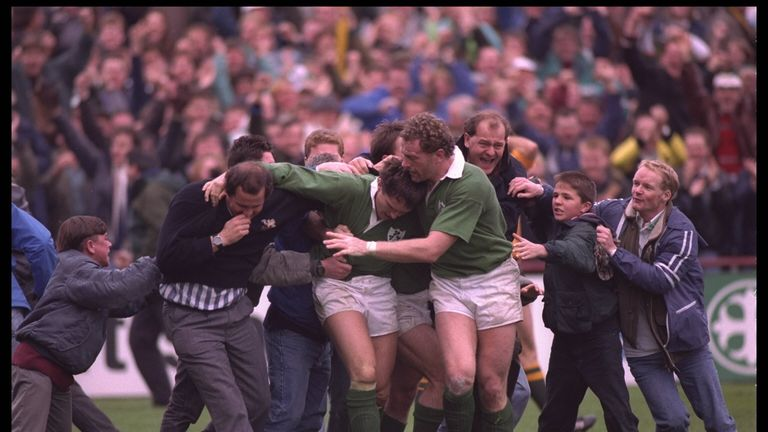 Gordon Hamilton of Ireland is mobbed after scoring a late try against Australia in the 1991 World Cup quarter-final