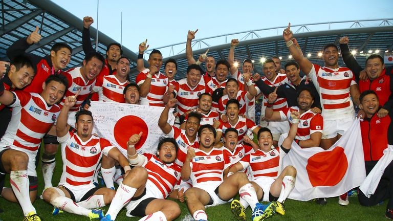 Japan players celebrate after their win over mighty South Africa