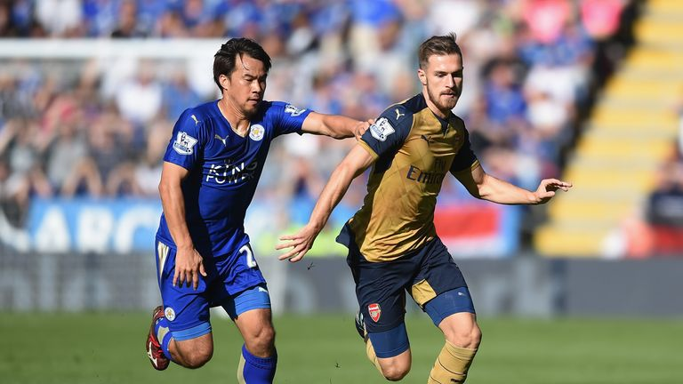 Leicester's Shinji Okazaki and Aaron Ramsey of Arsenal compete for the ball