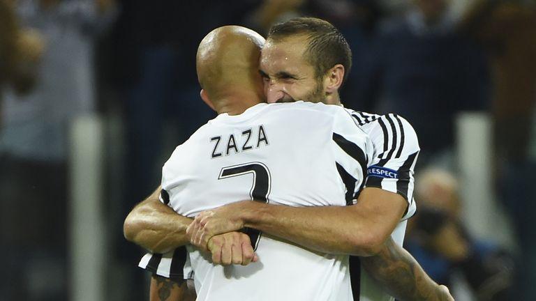 Juventus striker Simone Zaza celebrates with Giorgio Chiellini after scoring against Sevilla