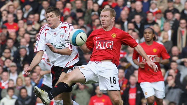 Paul Scholes of Manchester United clashes with Steven Gerrard of Liverpool during the Barclays FA Premier League match on March 23 2008