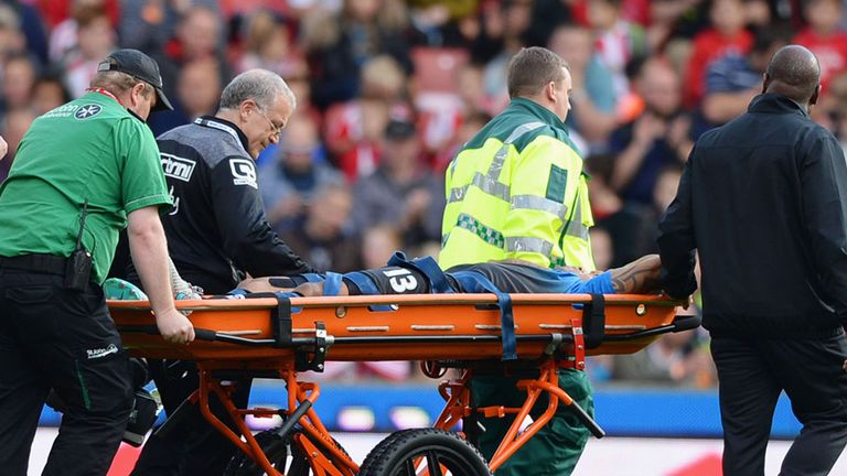 Callum Wilson leaves the field on a stretcher