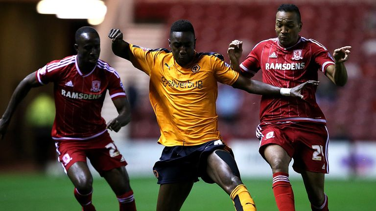 Sylvain Deslandes of Wolves battles with Albert Adomah and Emilio Nsue