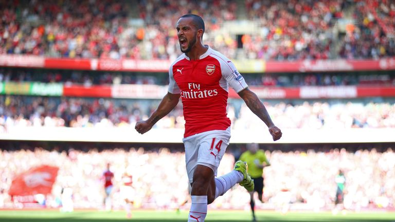 Theo Walcott of Arsenal celebrates scoring the opening goal during the Barclays Premier League match between Arsenal and Stoke City