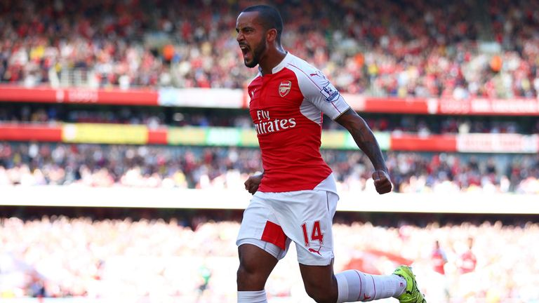 Theo Walcott of Arsenal celebrates scoring the opening goal against Stoke