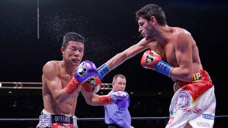 Tomoki Kameda takes a hit from Jamie McDonnell