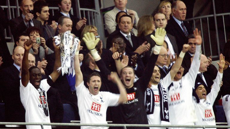 Tottenham's Robbie Keane (2nd L, front) and Ledley King (L, front) lift the trophy after winning the Carling Cup Final against Chelsea in 2008